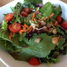 Napoli Salad with field greens, ripe cherry tomatoes, diced red onions, carrots, chickpeas, balsamic vinaigrette.